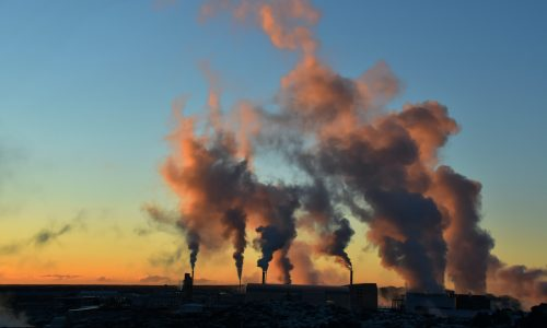 Power plants emit clouds of smoke into the environment